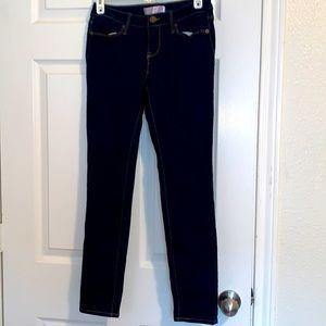Dark wash blue denim skinny jeans